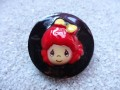 Large kawaii ring, Red doll, on a black resin background