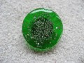 Fancy ring, silver microbeads, on green resin