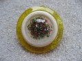 Very large ring, multicolored sequins, on white and yellow resin background