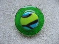 Large graphic ring, green/blue cabochon fimo, on green resin background