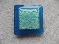 Very large square ring, blue minibeads, on a blue resin background