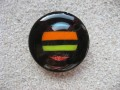 Large graphic ring, multicolored stripes cabochon, on a black resin background