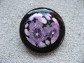 Very large graphic ring, cabochon with floral patterns in fimo, on a black resin background