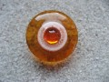 Fancy RING, orange pearl, on white and orange resin background