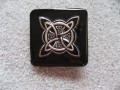 Large square ring, silver celtic knot, on black resin background