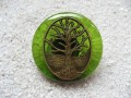 Large Zen ring, Bronze tree of life, on a green resin background