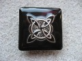 Very large square ring, silver celtic knot, on black resin background