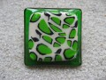Very large square ring, green and white leopard patterns in fimo, on a green resin background