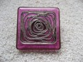 Large square ring, silver graphic print, on purple resin background