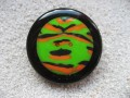 Very large ring, orange and green cabochon in fimo, on a black resin background