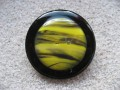 Very large ring, yellow and black cabochon in fimo, on a black resin background