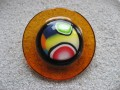 Very large ring, multicolored cabochon in fimo, on an orange resin background