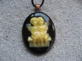 Oval pendant, the Cherubs, on black resin