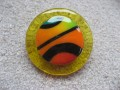 Very large ring, multicolored cabochon in fimo, on a yellow resin background