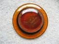 Very large graphic ring, glittery orange cabochon, on black and orange resin background