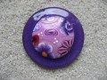 Very large ring, flower cabochon in fimo, on plum resin background