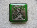 Large square ring, Silver graphic print, on green resin background